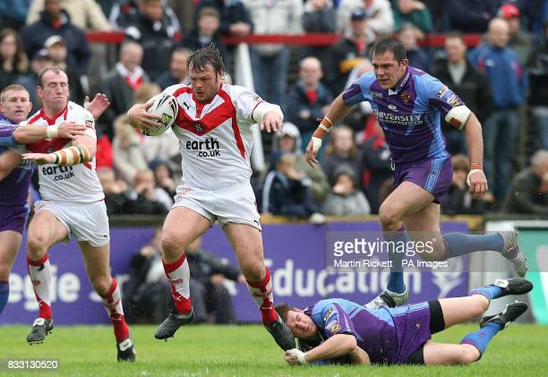 St Helens' Keiron Cunningham skips away from Stuart Jones and John Skandalis during the engage Super League match at Knowsley Road St Helens