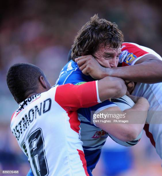 St Helens' Kyle Eastmond and Leon Pryce combine to stop Wigan's Martin Gleeson during the Engage Super League Qualifying Semi Final match at Knowsley...
