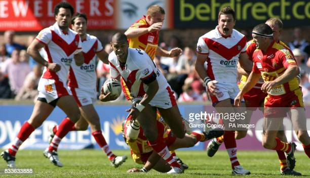 St Helens' Leon Pryce breaks the Catalans' line during the Powergen Challenge Cup quarterfinal match at Knowsley Road St Helens