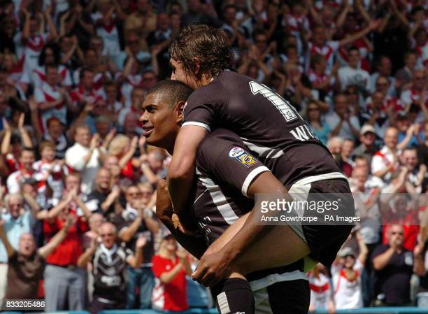 St Helens' Leon Pryce celebrates his try with Jon Wilkin during the Carnegie Challenge Cup SemiFinal match at the Galpharm Stadium Huddersfield