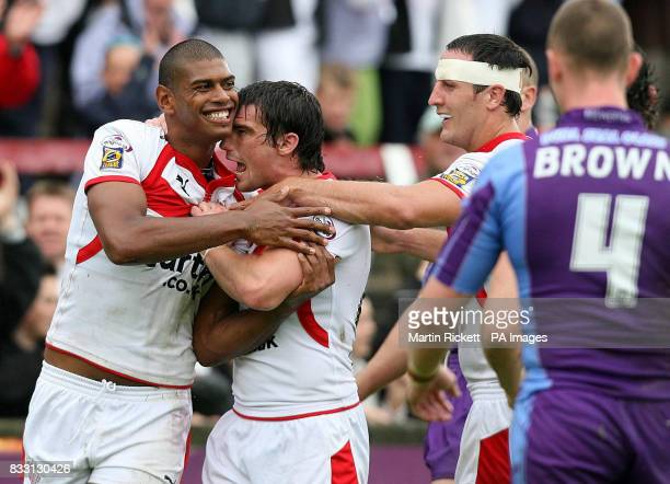 St Helens' Leon Pryce celebrates scoring a try with Matty Smith and Lee Gilmour during the engage Super League match at Knowsley Road St Helens