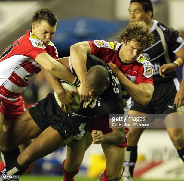 St Helens' Leon Pryce is brought down by Wigan's Sean O'Loughlin during the engage Super League match at The JJB Stadium Wigan