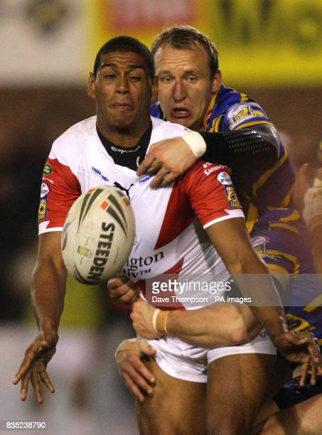 St Helens' Leon Pryce is held up by Leeds Rhinos' Carl Ablett during the engage Super League match at Knowsley Road St Helens