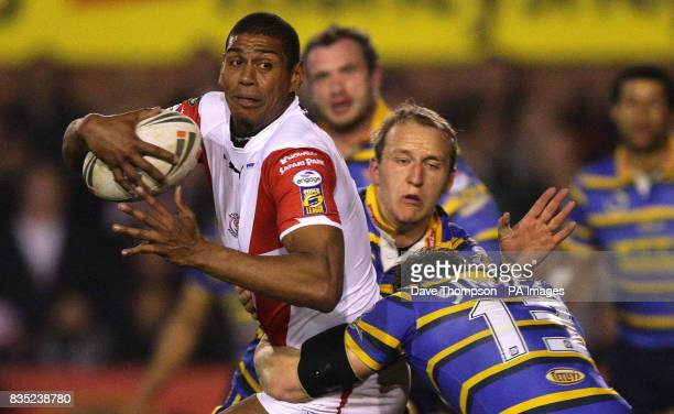 St Helens' Leon Pryce is held up by the Leeds Rhinos defence during the engage Super League match at Knowsley Road St Helens