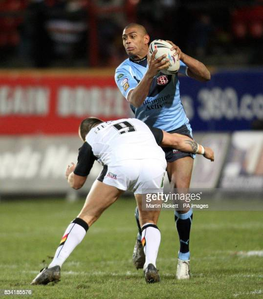 St Helens' Leon pryce is tackled by Bradford's Terry Newton during the engage Super League match at Odsal Stadium Bradford