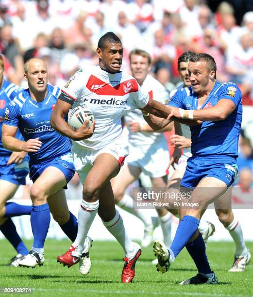 St Helens Leon Pryce is tackled by Hull KR's Josh Hodgson during the Carnegie Cup Quarter Final match at the Stobart Stadium Widnes