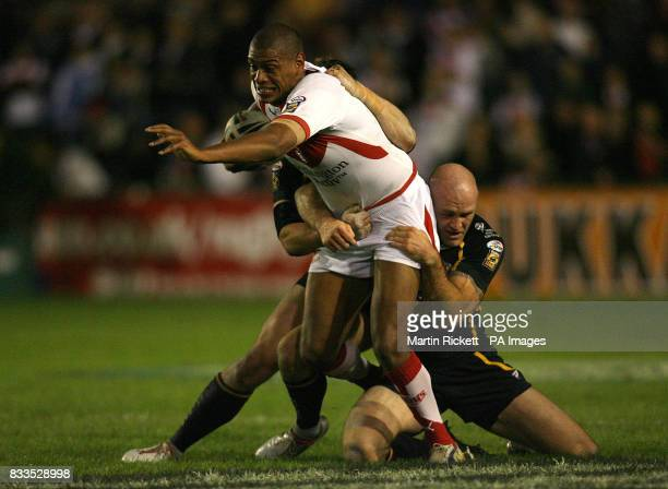 St Helen's Leon Pryce is tackled by Leeds' Keith Senior and Kevin Sinfield during the engage Super League Qualifying SemiFinal at Knowsley Road