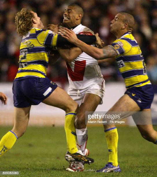 St Helens' Leon Pryce is tackled by Matty Blythe and Ben Westwood during the engage Super League match at Knowsley Road St Helens