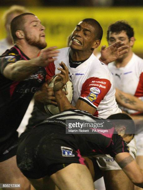 St Helens' Leon Pryce is tackled by Salford's Adam Sidlow and Robbie Paul during the engage Super League match at Knowsley Road St Helens