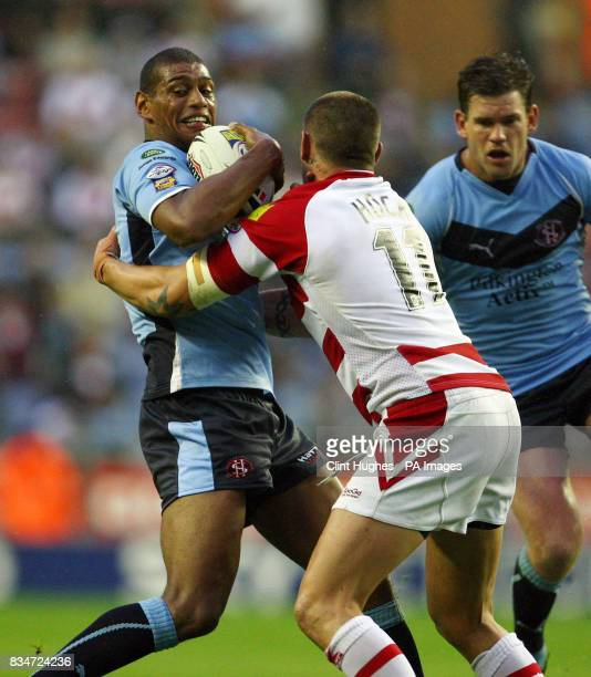 St Helens' Leon Pryce is tackled by Wigan's Gareth Hock during the engage Super League match at the JJB Stadium Wigan