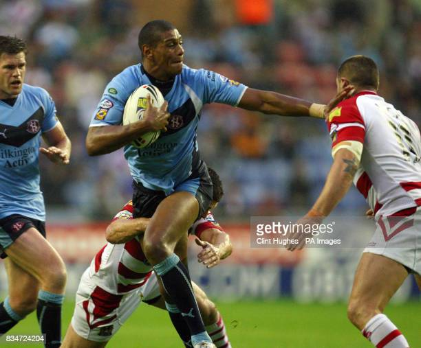 St Helens' Leon Pryce looks to hand off Wigan's Gareth Hock during the engage Super League match at the JJB Stadium Wigan