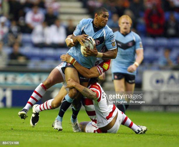 St Helens' Leon pryce tries to drive his way through the Wigan defence during the engage Super League match at the JJB Stadium Wigan