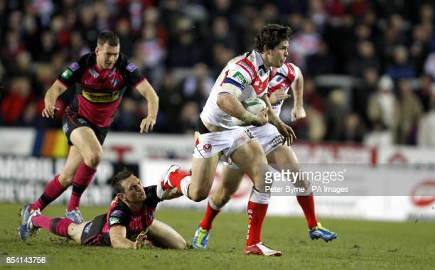 St Helen's Louie McCartheyScarsbrook is tackled by Leeds Rhino's Kevin Sinfield during the Super League match at Langtree Park St Helens