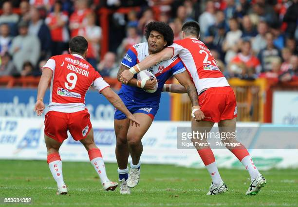 St Helen's Mose Masoe is tackled by Hull KR's Josh Hodgson and James Green during the First Utility Super League match at the KC Lightstream Stadium...