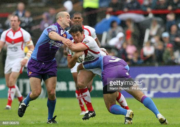 St Helens' Paul Wellens is tacked by Andy Raleigh and Jamahl Lolesi during the engage Super League match at Knowsley Road St Helens