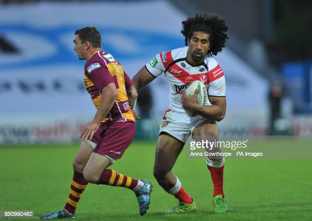 St Helens' Sia Soliola beats Huddersfield Giants' Danny Brough during the Super League match at the John Smith's Stadium Huddersfield