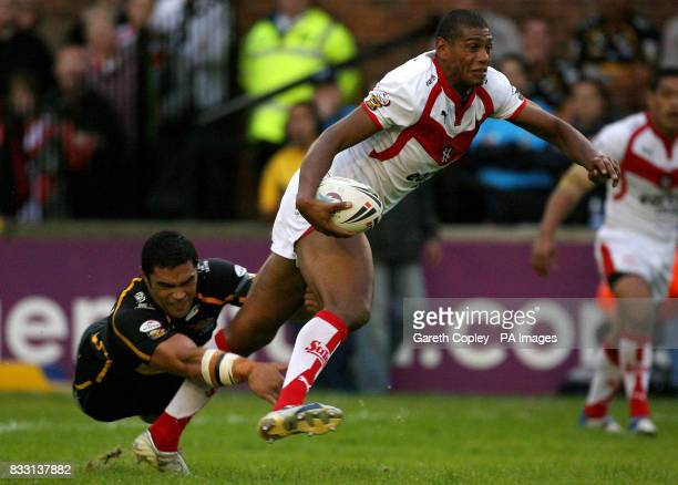 St Helens's Leon Pryce breaks from a tackle of Leeds's Kylie Lauluai during the engage Super League match at Knowsley Road St Helens
