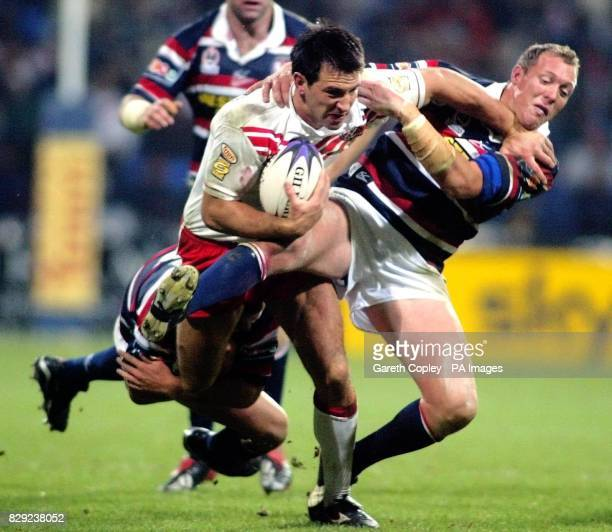 St Helens's Paul Sculthorpe hands off Sydney City Rooster's Craig Fitzgibbon during their World Club Challenge game at Bolton's Reebok Stadium