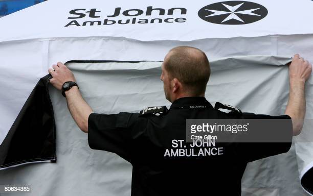 St John Ambulance volunteer Martin Warnes sets up a new first aid tent in preparation for the London Marathon on April 11 2008 in London England 1400...