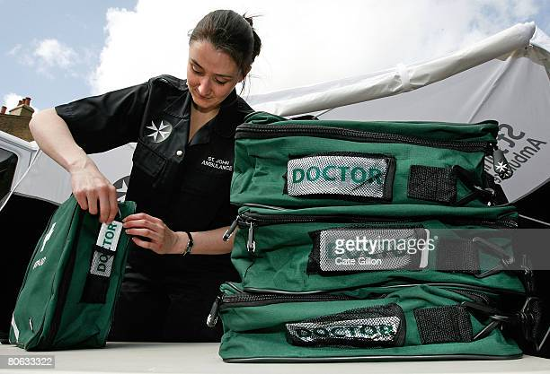 St John Ambulance volunteer Vanessa Bryson lays out syringes for doctors' kits in preparation for the London Marathon on April 11 2008 in London...