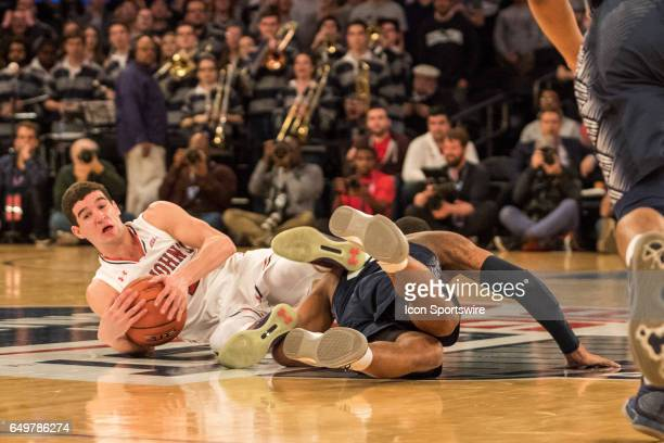 St John Guard Federico Mussini and Georgetown Guard Rodney Pryor scramble for a loose ball during the first round of the BigEast Conference men's...