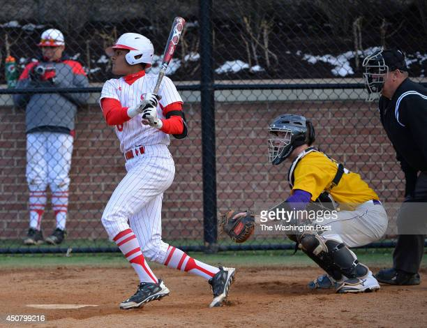 St John's AJ Lee looks up at his 1 run double in the third inning against Lake Braddock at St John's College High School on March 27 2014 in...