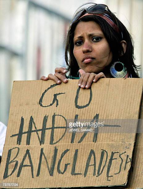 St John's ANTIGUA AND BARBUDA A cricket fan holds a placards with India crossed on it as she watches the ICC World Cup 2007 Super Eight match between...