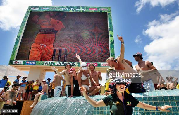 St John's ANTIGUA AND BARBUDA Australian cricket fans celebrate their victoy over West Indies on a pool at the end of the ICC World Cup Super Eight...