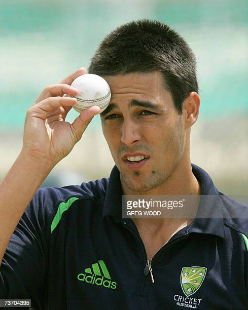 St John's ANTIGUA AND BARBUDA Australian fast bowler Mitchell Johnson wipes the ball on his forehead as he trains with teammates in Antigua 26 March...