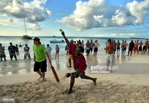 St John's ANTIGUA AND BARBUDA Former West Indies cricket team captain Richie Richardson delivers a ball during a beach cricket game between the...