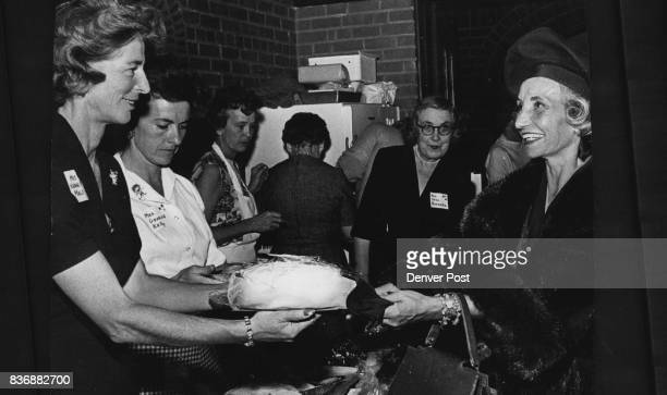 St John's Bazaar Bakery Shop Does Booming Business Mrs L R Kintzele right buys cake from Mrs Kenneth Malo and helpers Mrs George Kelly and Mrs Otto...