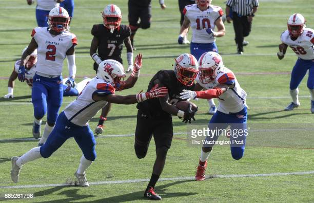 WASHINGTON DC OCTOBER St John's College Cadets wide receiver Charles Briscoe splits DeMatha Stags Dominic LoganNealy left and DeMatha Stags...