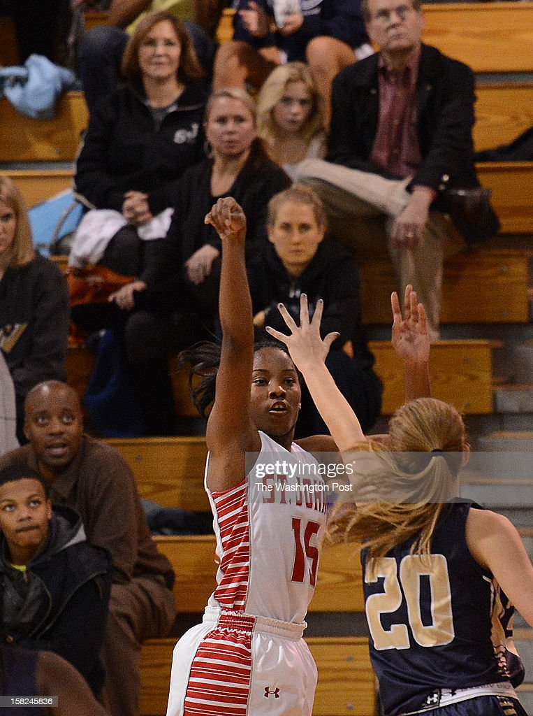 St. John's College senior Lindsay Allen watches as her three point shot goes towards the basket during the game at St. John's College High School on Tuesday, December 11 2012. St. John's defeated Good Counsel 77-73.