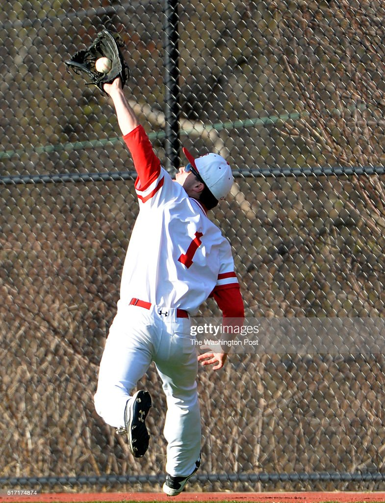 MARCH 23, 2016- St. John's Kyle Johnson goes to the fence to catch a hit by Lake Braddock's Jack Darcy on March 23, 2016 in Washington, DC.