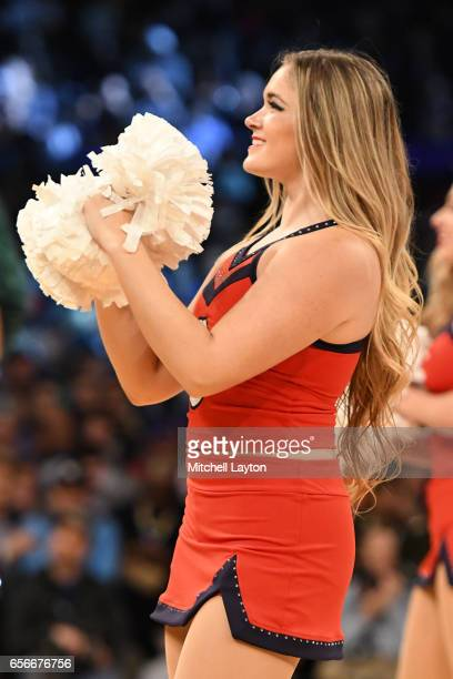 St John's Red Storm cheerleader performs on the floor during the Big East Basketball Tournament First Round game against the Georgetown Hoyas at...