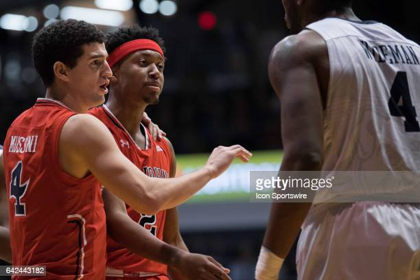St John's Red Storm guard Federico Mussini steps in between Butler Bulldogs forward Tyler Wideman and St John's Red Storm guard Shamorie Ponds during...