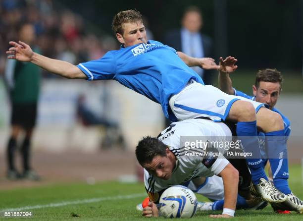 St Johnstone's David Wotherspoon challenges Rosenborg Nicki Nielsen during the UEFA Europa League second round second leg match at McDiarmid Park...