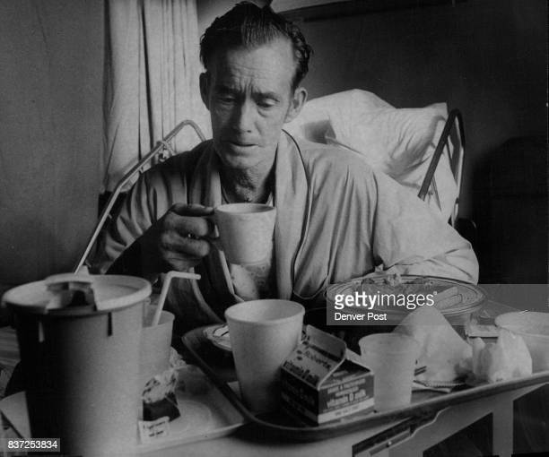 St Joseph Hospital Charles Younger takes breakfast in bed at St Joseph Hospital He came to Denver for openheart surgery after reading of technique in...