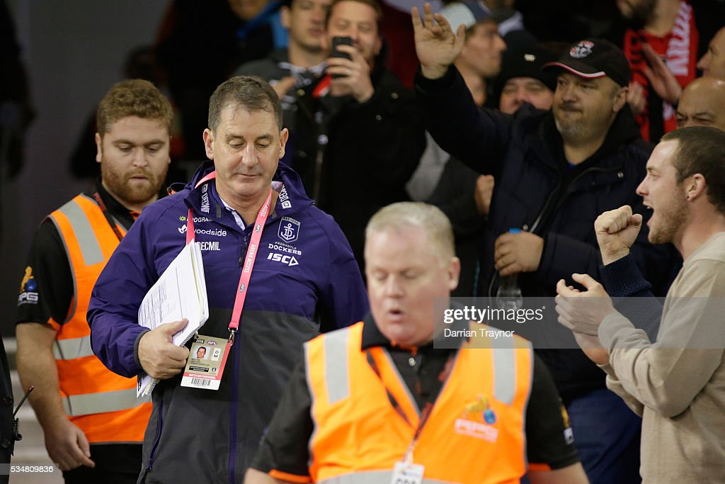 St Kilda fans jeer Ross Lyon, Senior Coach of the Dockers as he walks through the crowd after the round 10 AFL match between the St Kilda Saints and the Fremantle Dockers at Etihad Stadium on May 28, 2016 in Melbourne, Australia.