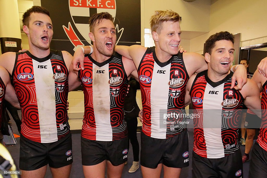 St Kilda players sing the team song after the round 10 AFL match between the St Kilda Saints and the Fremantle Dockers at Etihad Stadium on May 28, 2016 in Melbourne, Australia.