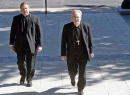St Louis Archbishop Justin Rigali enters the Archdiocesan Pastoral Center in St Louis with monsignor Robert Stika for a press conference September 29...