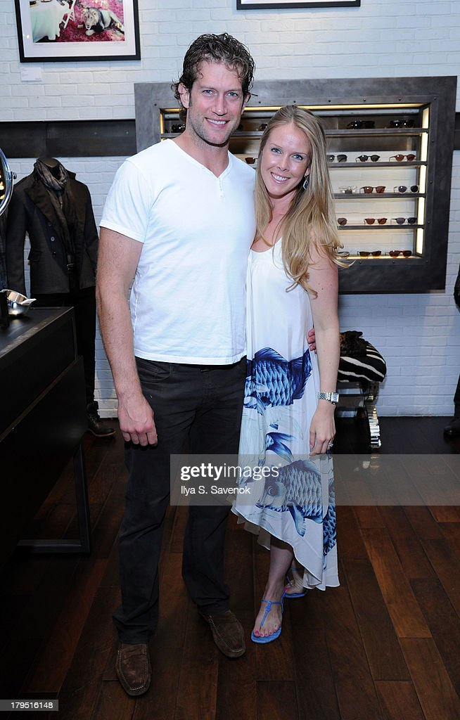 St. Louis Blues captain <a gi-track='captionPersonalityLinkClicked' href=/galleries/search?phrase=David+Backes&family=editorial&specificpeople=2538492 ng-click='$event.stopPropagation()'>David Backes</a> (L) and his wife attends John Varvatos event as part of 2013 NHL/NHLPA Player Media Tour on September 4, 2013 in New York City.