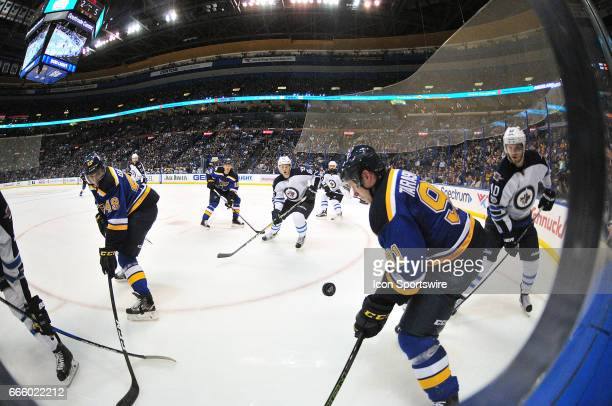 St Louis Blues center Ivan Barbashev and St Louis Blues rightwing Vladimir Tarasenko go after a loose puck on the boards during an NHL game between...