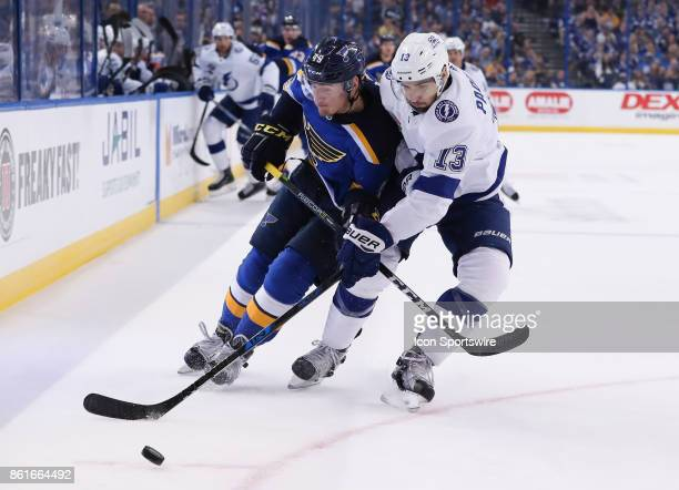 St Louis Blues center Ivan Barbashev and Tampa Bay Lightning center Cedric Paquette in action in the 1st period of the NHL game between the St Louis...