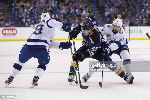 St Louis Blues center Ivan Barbashev is defended by Tampa Bay Lightning defenseman Slater Koekkoek and Tampa Bay Lightning center Cedric Paquette in...