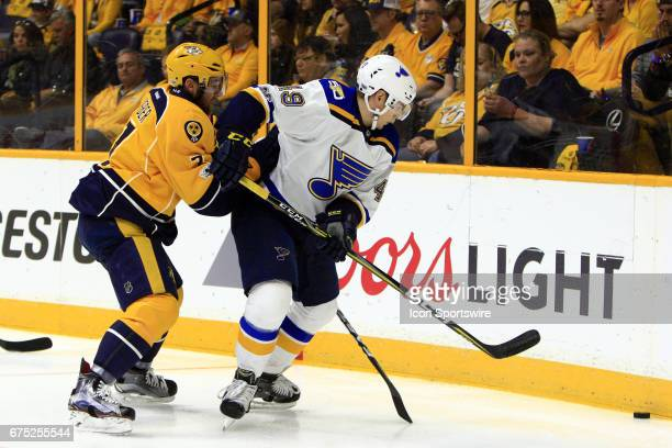 St Louis Blues center Ivan Barbashev shields Nashville Predators defenseman Yannick Weber from the puck during game three of Round Two of the Stanley...