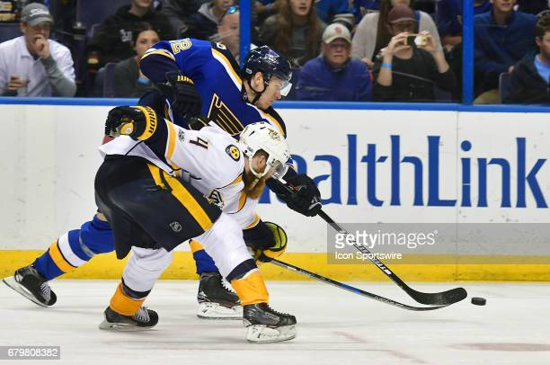 St Louis Blues center Jori Lehtera battles with Nashville defenseman Ryan Ellis for the puck in the second period during game five of the second...