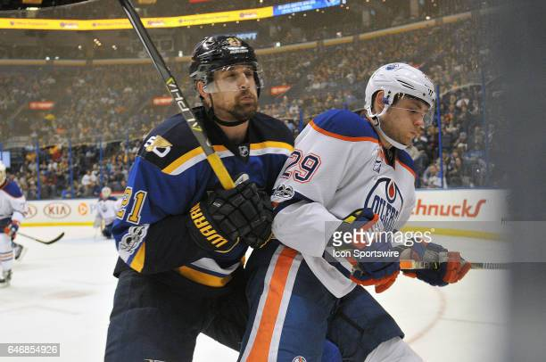 St Louis Blues center Patrik Berglund and Edmonton Oilers' center Leon Draisaitl compete for a loose puck on the boards during a NHL game game...