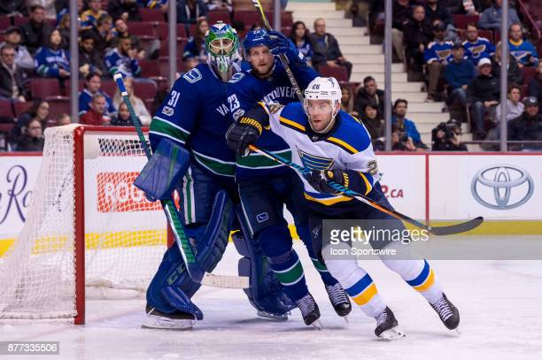 St Louis Blues Center Paul Stastny and Defenceman Alexander Edler skate in front of Vancouver Canucks Goalie Anders Nilsson during their NHL game at...