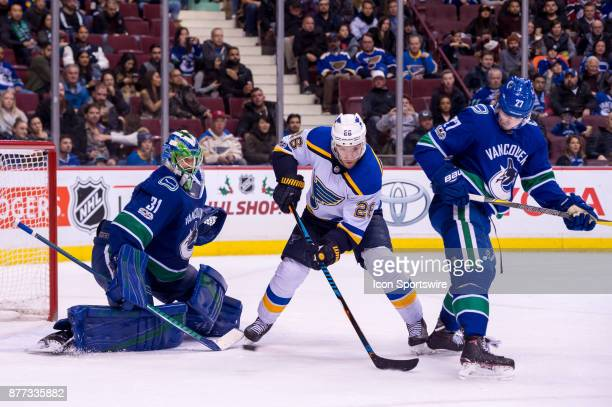 St Louis Blues Center Paul Stastny tries to deflect the puck in front of Vancouver Canucks Goalie Anders Nilsson as Vancouver Canucks Defenceman Ben...